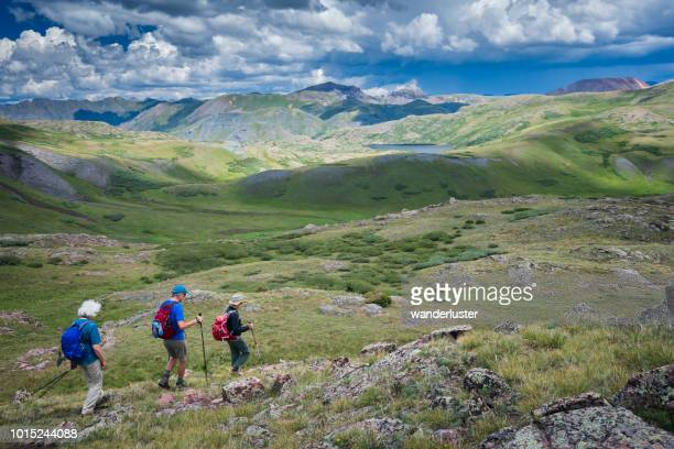 three senior adults hiking in san juan mountains - san juan mountains stock photos and pictures