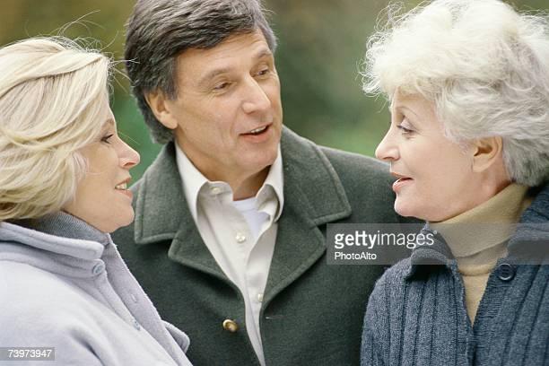 Three senior adults, talking, head and shoulders