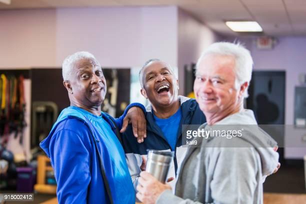 three senior men hanging out at gym, talking - only senior men stock pictures, royalty-free photos & images