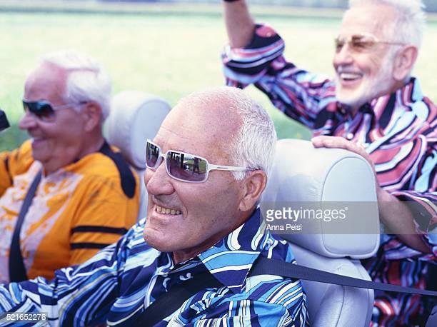 Three Senior Men in Convertible