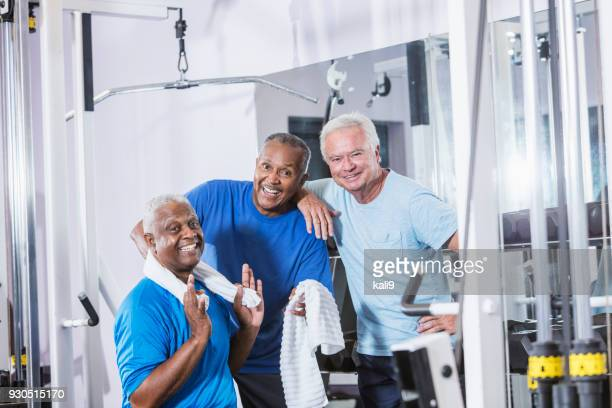three senior multi-ethnic men working out at gym - only senior men stock pictures, royalty-free photos & images