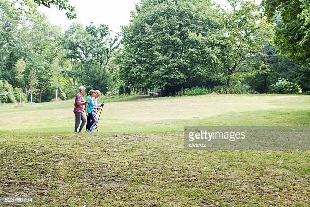 Three senior woman walking in the park