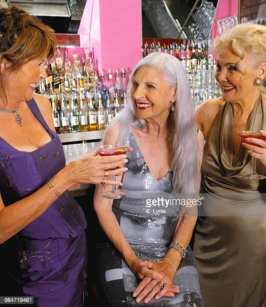 Three Senior Women Having Cocktails at a Bar