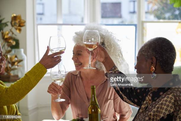 Three senior women having fun laughing together
