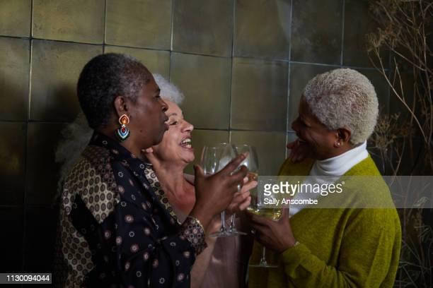 Three senior women having laughing together