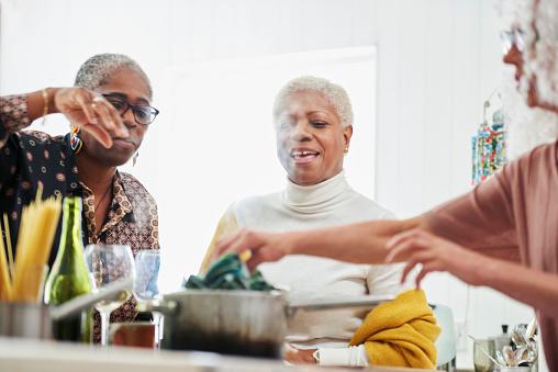 three senior women in kitchen cooking - gettyimageskorea