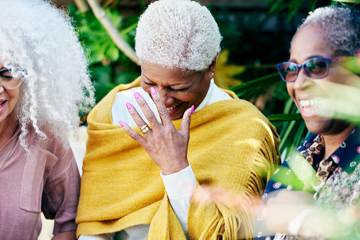 three senior women laughing in garden - gettyimageskorea