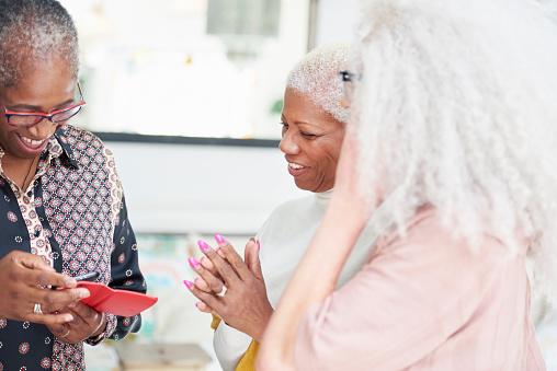 three senior women looking at smart phone - gettyimageskorea