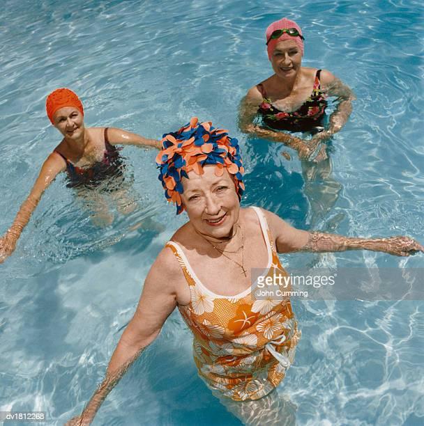 Three Senior Women Standing in Swimming Pool
