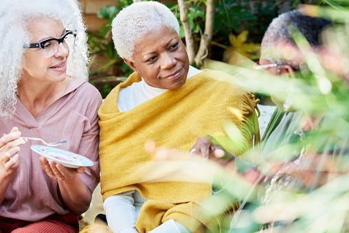 three senior women talking in garden - gettyimageskorea