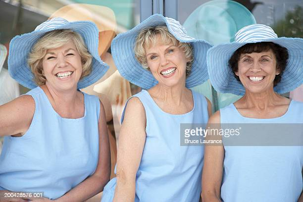Three senior women wearing the same outfit smiling, portrait