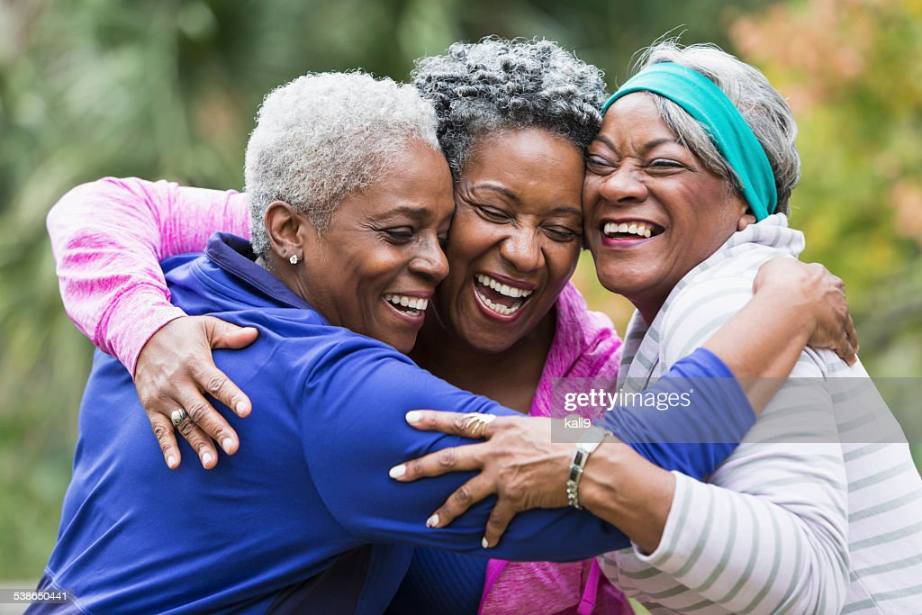 Three seniors hugging : Stock Photo