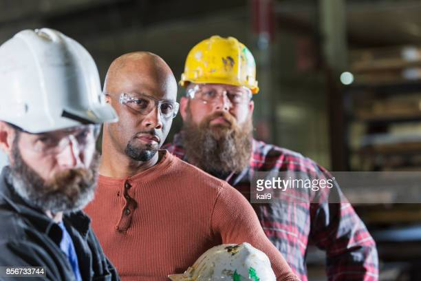 three serious multi-ethnic construction workers - toughness stock pictures, royalty-free photos & images