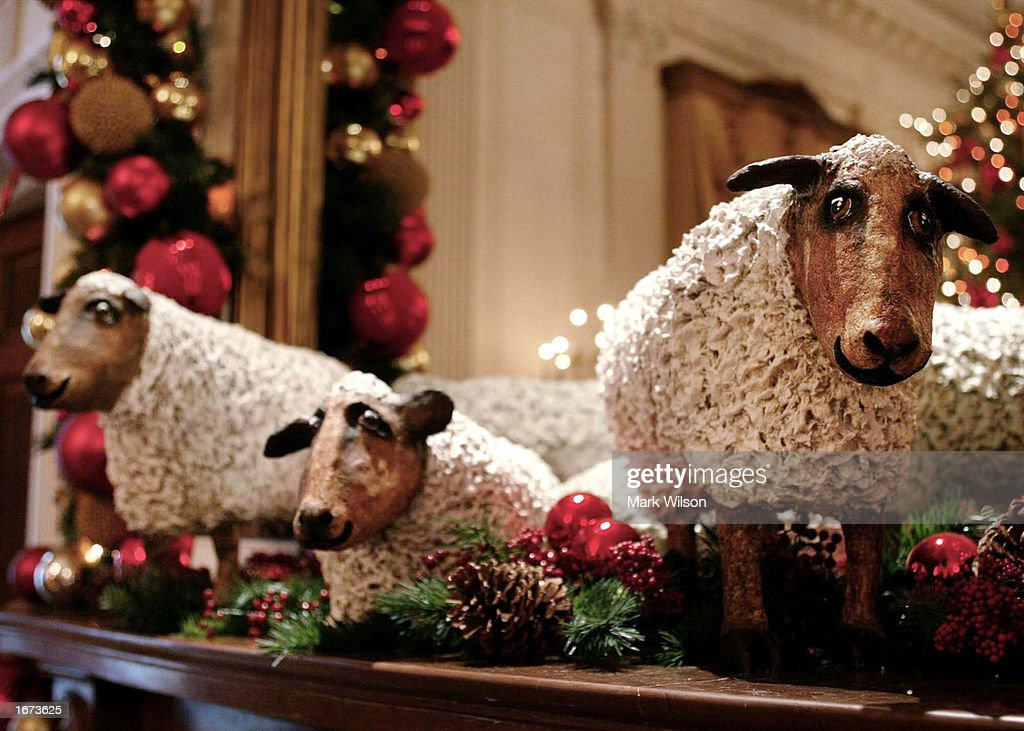 Three Sheep Decorations Sit On A Mantle In The East Room Of
