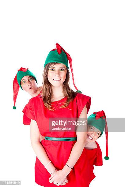 Three Siblings Dressed Up As Christmas Elves