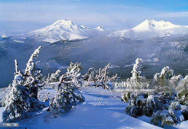 """three sisters and broken top mountains in snow, central cascades"" - dan peak stock photos and pictures"