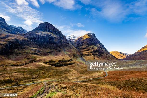 three sisters of glencoe frame the valley - travel stock pictures, royalty-free photos & images