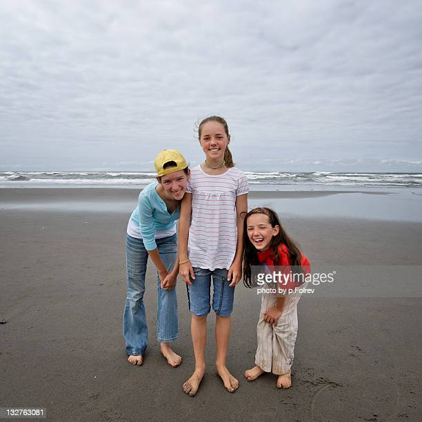 Three sisters posing in front of Pacific Ocean