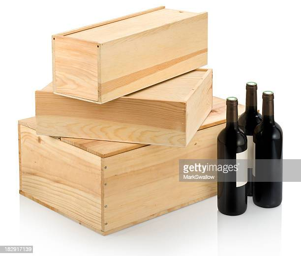 Three sizes of wine boxes and accompanying wine