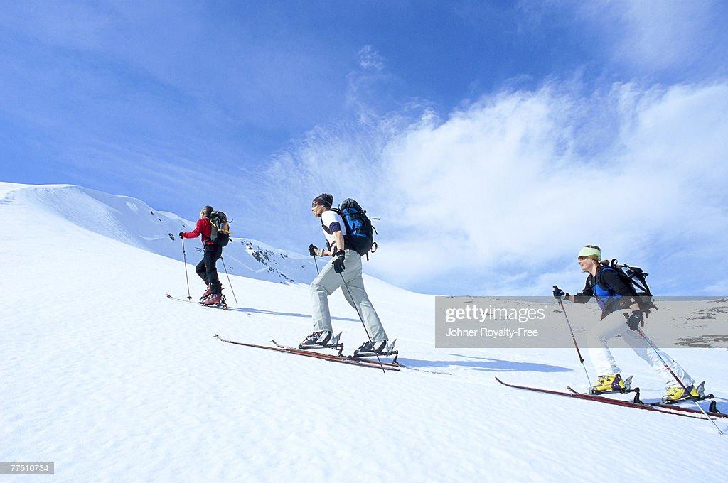 Three skiers going up the ski slope Storulvan Jamtland Sweden. : Stock Photo