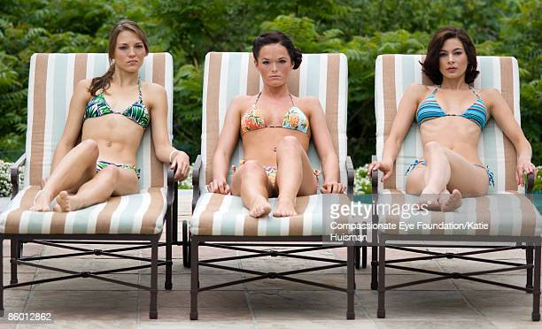"""three skinny women scowling on lounge chairs - """"compassionate eye"""" stock pictures, royalty-free photos & images"""