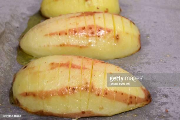 three sliced roasted potato - rafael ben ari bildbanksfoton och bilder