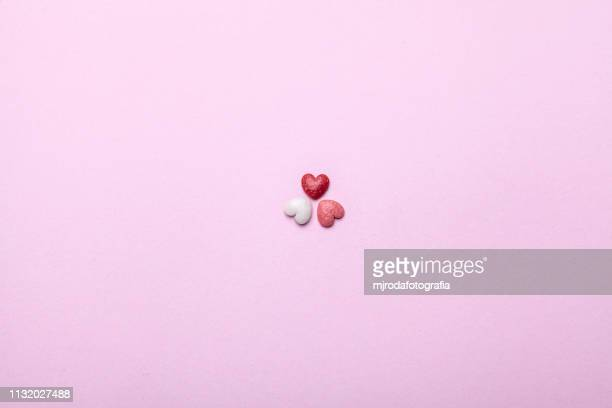 three small hearts - inspiración stock pictures, royalty-free photos & images