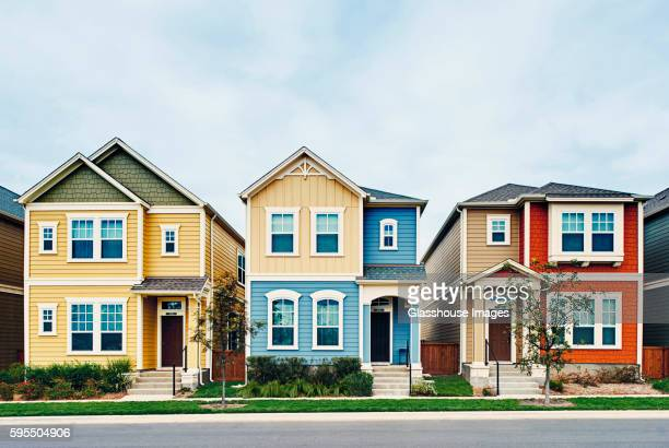 three small houses in row - house stock pictures, royalty-free photos & images