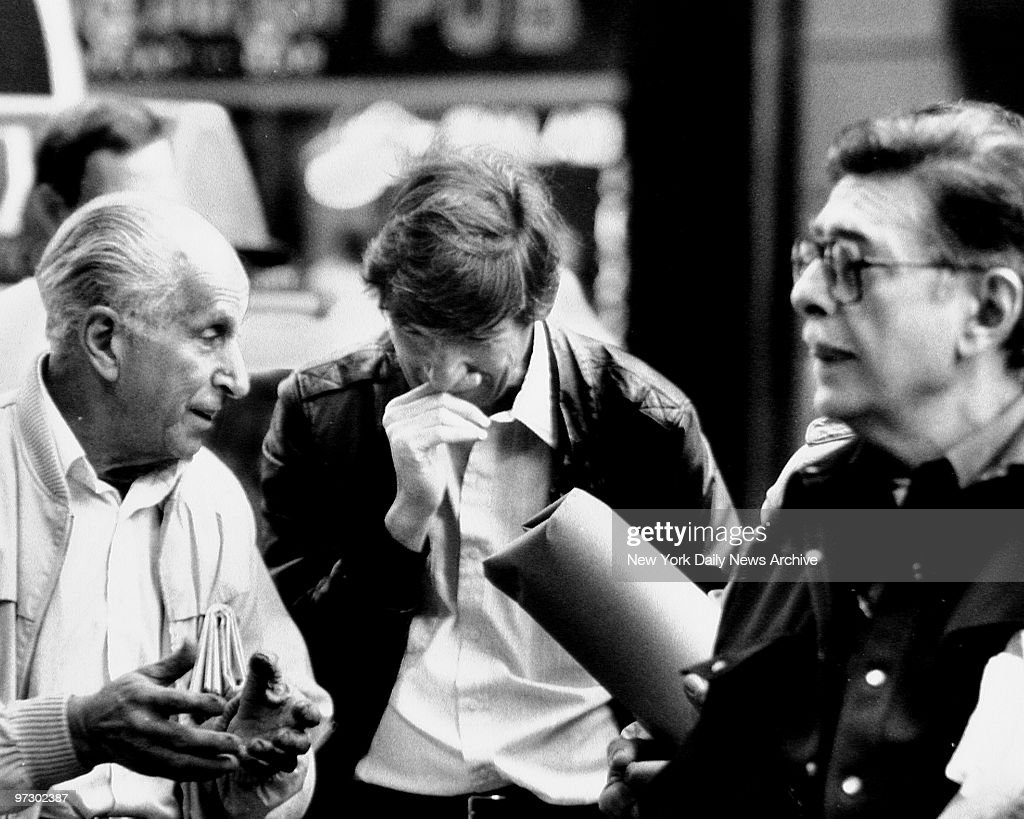 Three small investors watch the stock quotations in front of Stock Exchange on Black Monday, Manhattan.