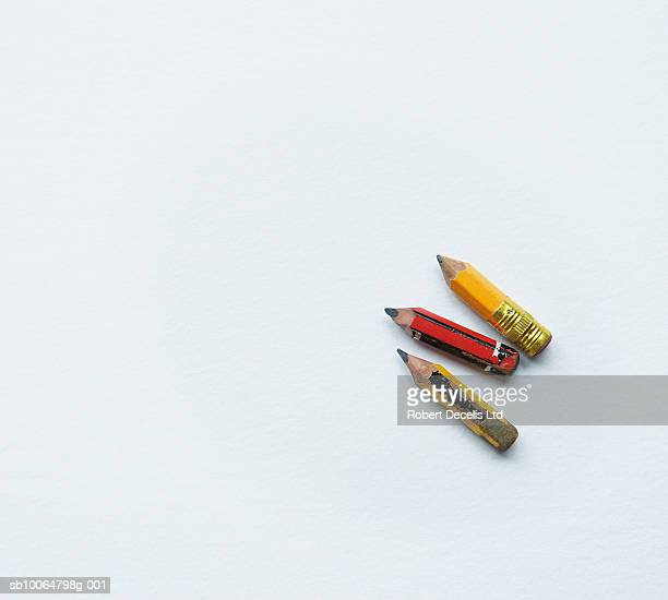Three small pencils on white background