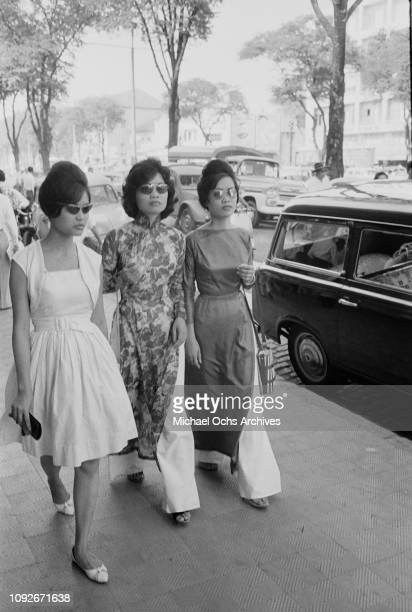 Three smart young women in Saigon South Vietnam during the Vietnam War March 1962