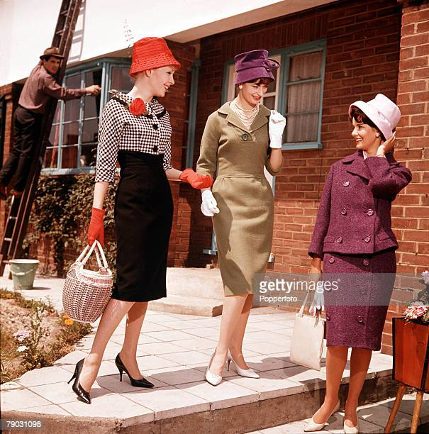 Three smartly dressed women leave the house for a summer stroll leaving the window cleaner behind One woman carries a shopping basket and is wearing...