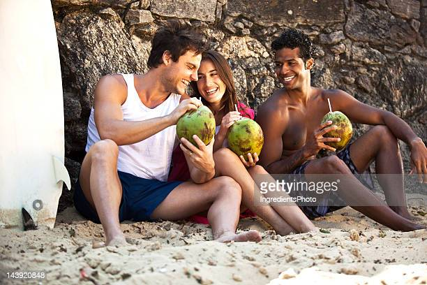 Three smiling friends having fun on the beach.