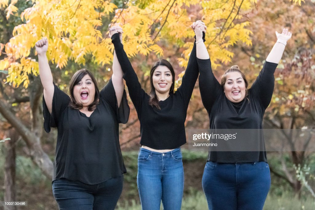 Three smiling women posing together : Stock Photo