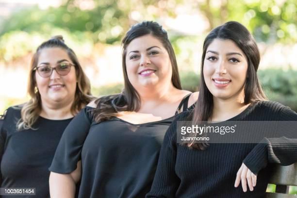 Three smiling women posing together