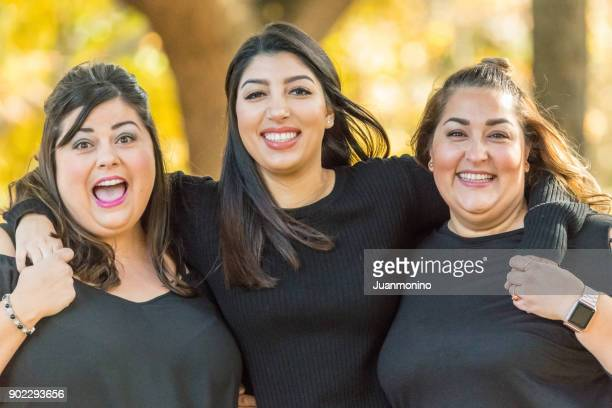 three smiling women posing together - arab women fat stock pictures, royalty-free photos & images