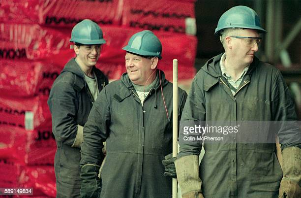 Three smiling workers at the Govan shipyard on the banks of the river Clyde in Glasgow At the time of this photograph the shipyard was owned by...