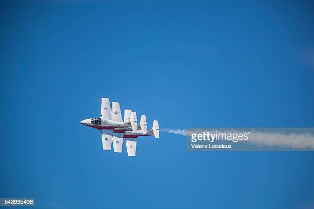 three snowbirds in a blue sky - canadian forces snowbirds stock pictures, royalty-free photos & images