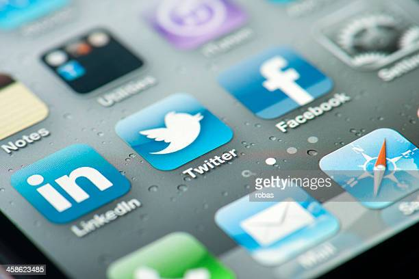 three social media icons on iphone screen - online messaging stock pictures, royalty-free photos & images