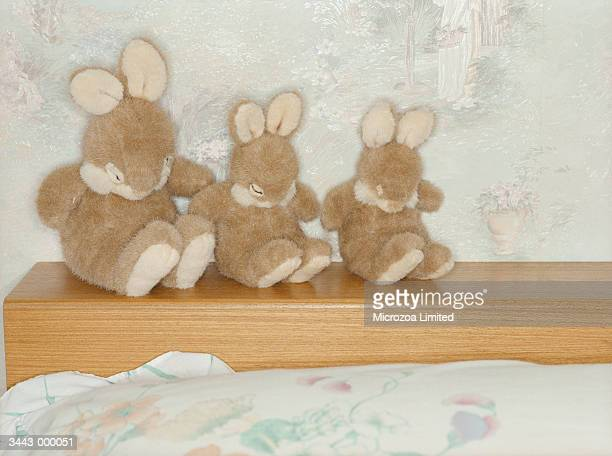 three soft toy rabbits - microzoa stockfoto's en -beelden