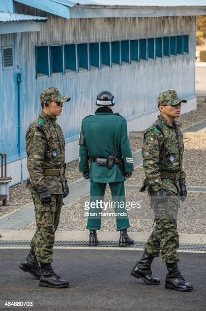 CONTENT] Three soldiers at the DMZ This is an area that has seen many violent incidents in the years since the cease fire went into effect North...