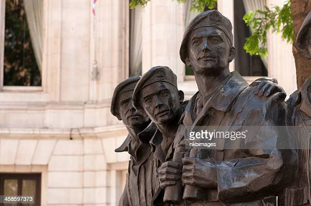 Three soldiers from Royal Tank Regiment Memorial Statue