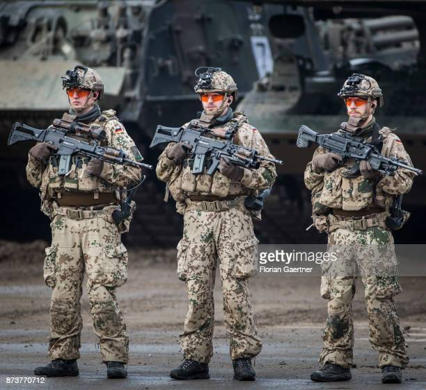 Three soldiers with equipment 'Infantryman of the Future Extended System and rifles Shot during an exercise of the land forces on October 13 2017 in...