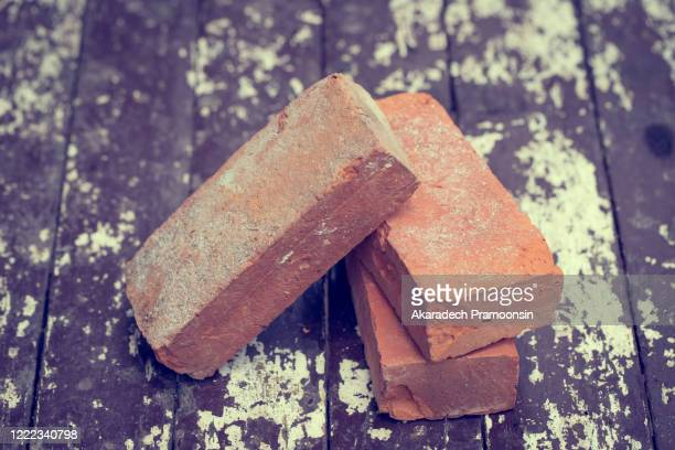 three solid bricks placed on the table - 固体 ストックフォトと画像