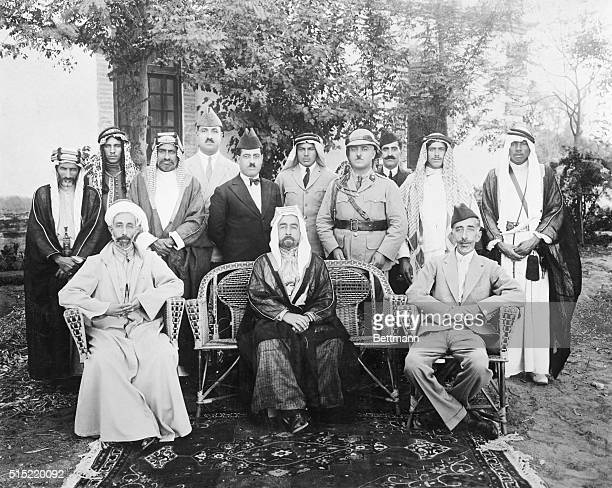 Three sons of the Sharif of Mecca Hussein seated left to right Faisal I King of Iraq Abdullah Emir of Transjordania and Ali who was briefly the king...