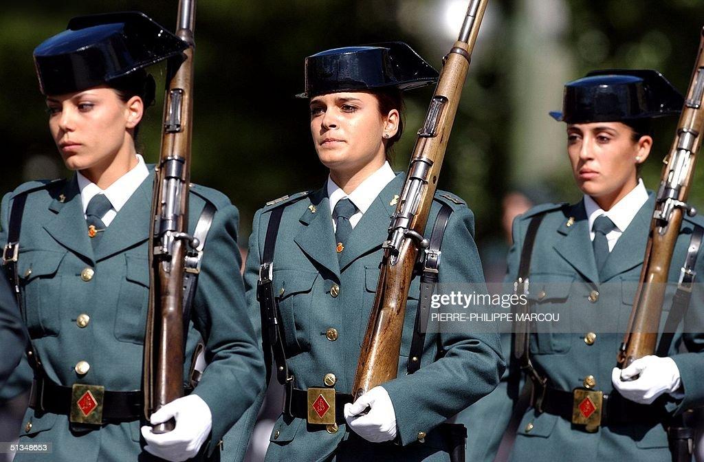 "Three Spanish ""Guardia Civil"" women parade during : News Photo"