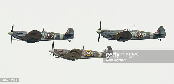 Three Spitfire fighters take part in a Battle of Britain flypast on August 18, 2015 in Biggin Hill, England. A total of 18 Spitfires and six...