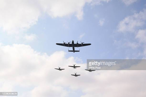 Three Spitfires, a Hurricane and a Lancaster bomber fly over the national service of remembrance marking the 75th anniversary of VJ Day at the...