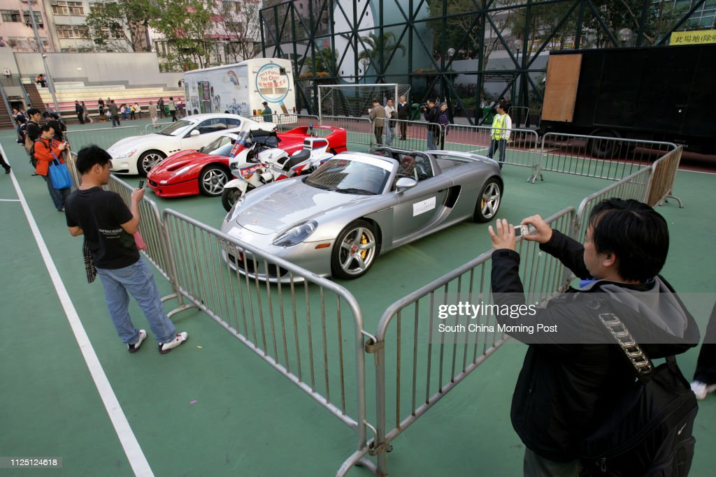 Three sport cars  -  (L to R) Maserati (GranTurismo S); Ferrari (F50) and Porsche (Carrera GT) being display on 2007/08 Wan Chai District Road Safety and Environmental Protection Carnival at Wanchai. 01 MARCH 2008 : News Photo
