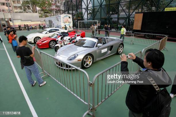 Three sport cars Maserati Ferrari and Porsche being display on 2007/08 Wan Chai District Road Safety and Environmental Protection Carnival at Wanchai...
